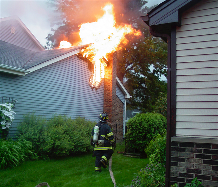 fire fighters responding to fire in a home